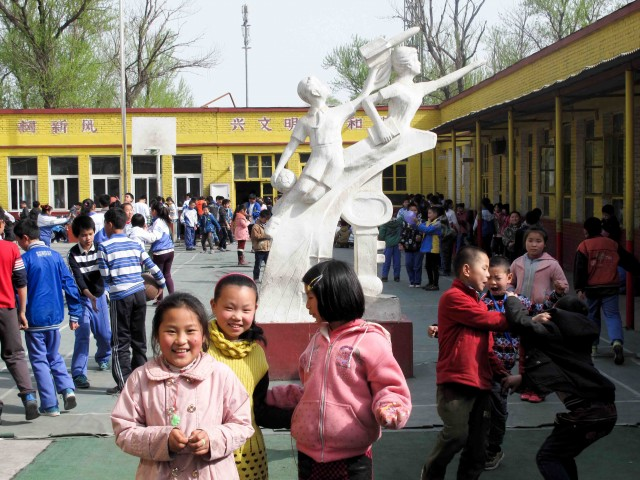 Schoolyard with iconic Leap to the Future statue